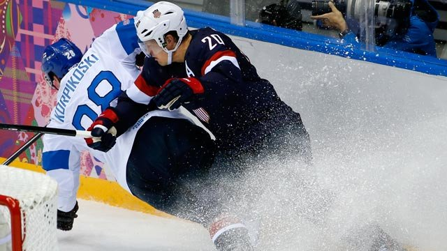 Lauri Korpikoski of Finland (28) and Ryan Suter of the United States (20) crash into the boards during the third period of the men's bronze medal ice hockey game at the 2014 Winter Olympics, Saturday, Feb. 22, 2014, in Sochi, Russia. (AP Photo/Matt Slocum