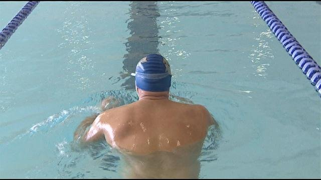 Kim Garbarino of Winthrop is attempting to swim for 24 hours straight to raise money for charity.